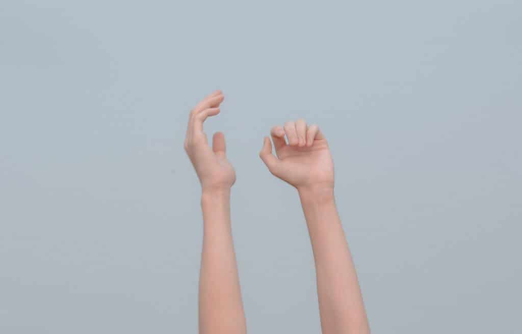 image of hands reaching to the sky